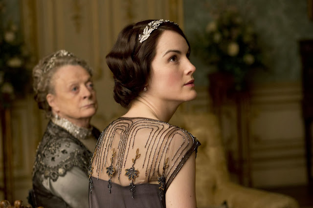 'DOWNTON ABBEY,' SERIES FOUR (2013). Hugh Bonneville and Michelle Dockery co-star in the fourth year of ITV's period drama. Text © Rissi JC