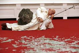 Cattelan's controversial waxwork of Pope John Paul II felled by a meteorite