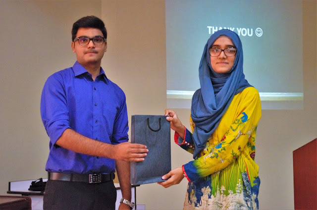 Syed Faizan Ali giving gifts to the winner of the Q/A Session