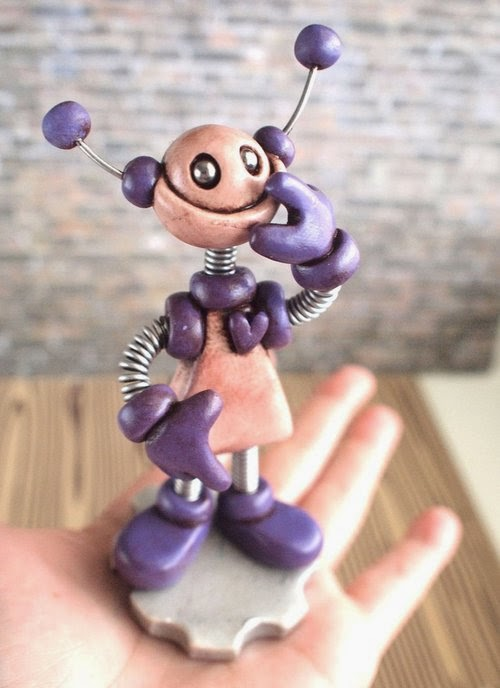 13-Purple-Pat-Grungy-Bot-HerArtSheLoves-Clay-Robot-World-Sculptures-www-designstack-co