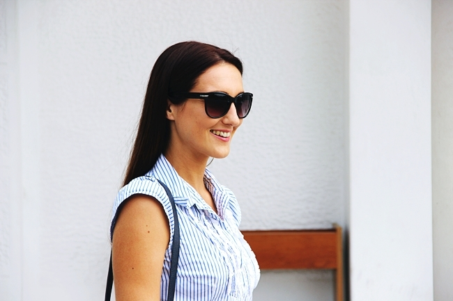 Weekend Max Mara white-blue striped shirt with ruffles.H&M black sunglasses.