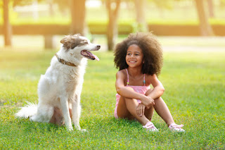 A girl with her pet dog... Using canine science to encourage girls to get into science