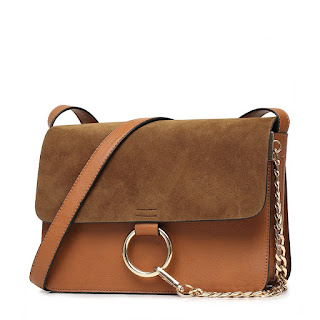 clutch swag brown color bag.