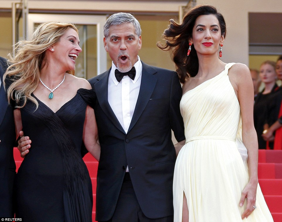Amal Clooney Struggles With Thigh Split Gown At The Cannes
