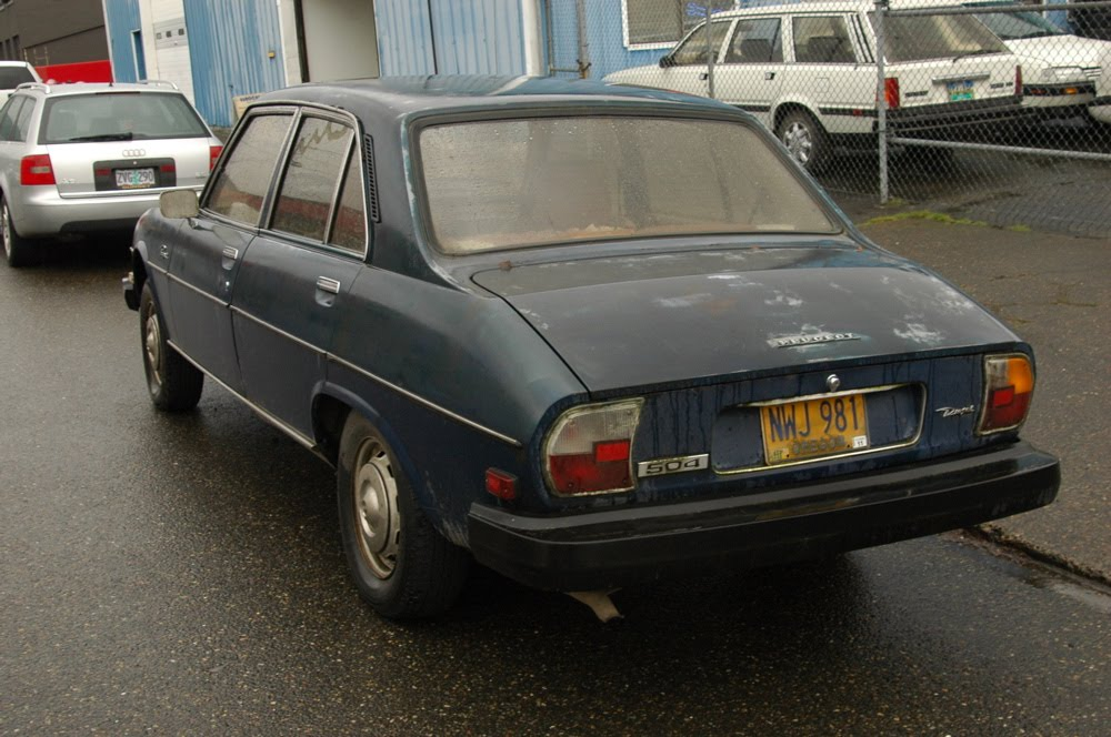 old parked cars.: 1979 peugeot 504 diesel sedan.