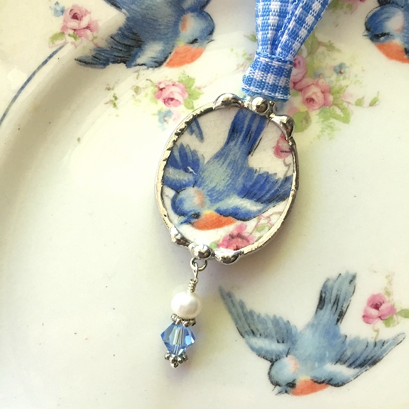 broken china jewelry bird