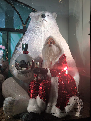 Pic of large polar with Santa sitting on his lap