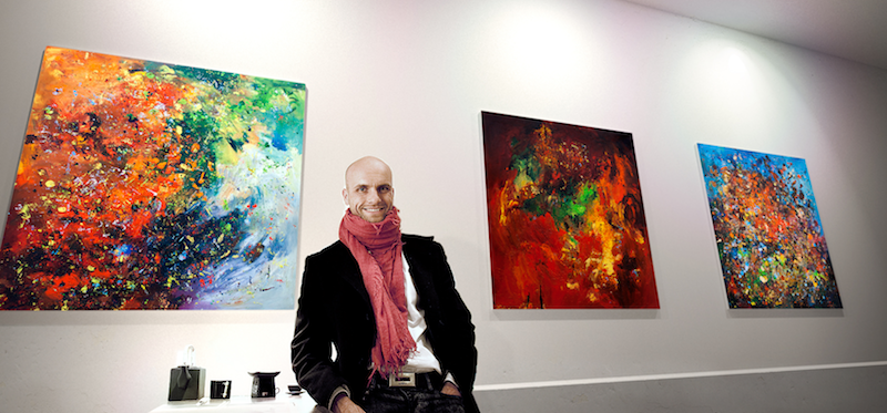 Radim Kacer with his abstract artworks