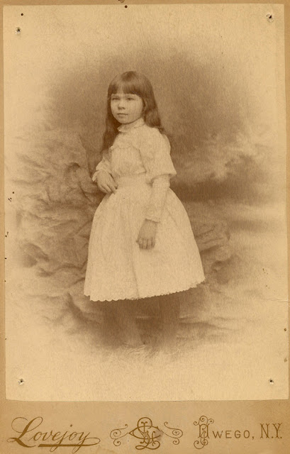 Lena E. MacKenzie, posing at the Lovejoy Photography Studio, Owego, NY. The photo is dated 3 May 1896.