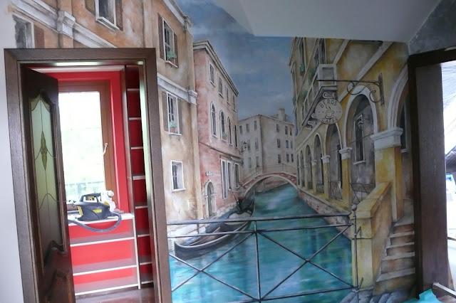 Artystyczne malowanie ściany, grafika ścienna przedstawiająca widok wenacji.