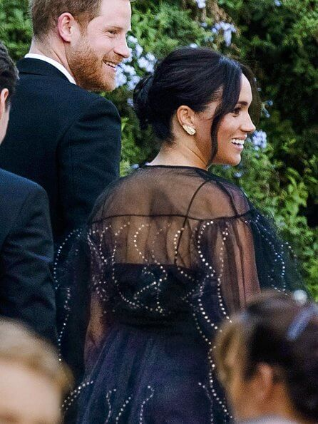 Meghan Markle wore an £8,900 black puff sleeved embroidered tulle gown by Valentino. Princesses Eugenie and Beatrice