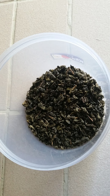 Aromatic cured tea leaves in a plastic container