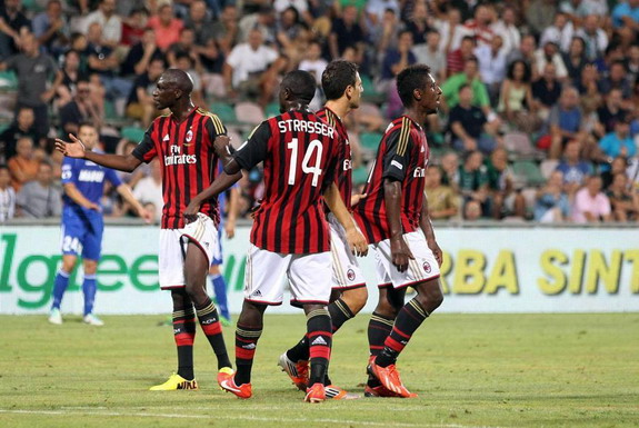 Kevin Constant is held back by AC Milan teammates before walking out of match against Sassuolo