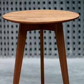 Image of a small round coffee table with the legs