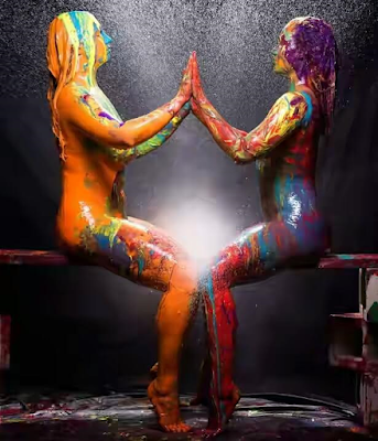 Nude girl covered in paint