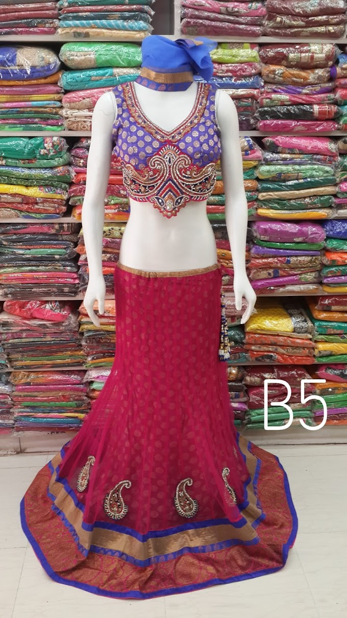 boutique lehenga design with net fabric and unique redy made blouse by sharmili saree