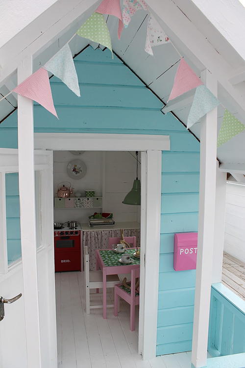 Outside The most amazing little DIY Play Shed for Girls! That pink post box is fabulous, love the bunting too
