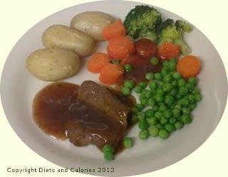 Roast beef in gravy yorkshire pudding vegetables