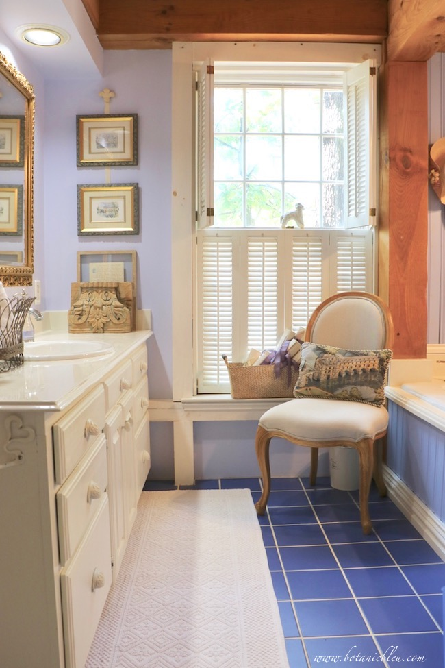 reproduction french style chair in master bathroom adds french country style