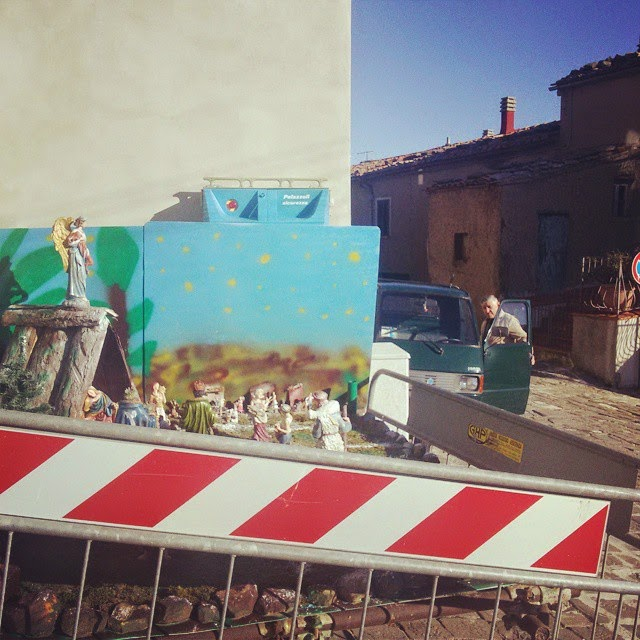 Nativity scene and road signs in Monticello Amiata