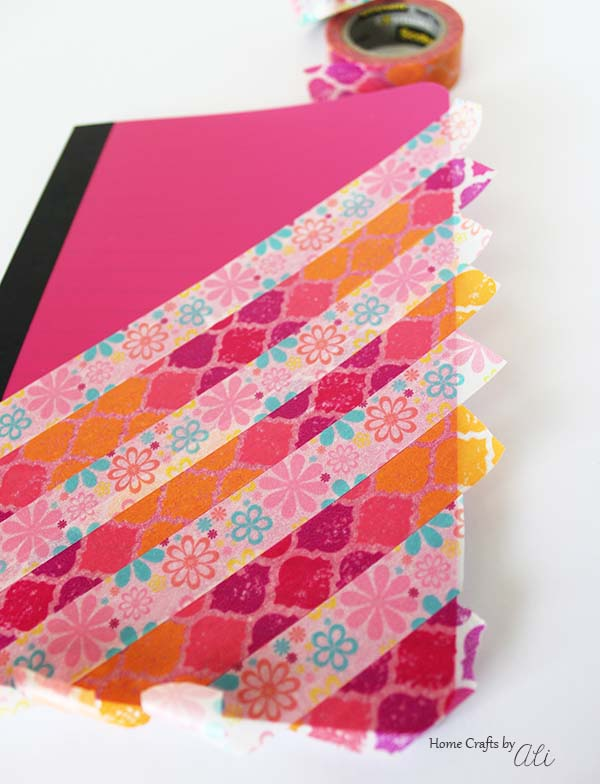 use washi tape to decorate a mini notebook