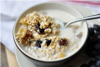 Oatmeal with whole milk raisins and walnuts