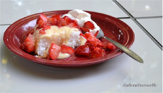 strawberries, custard, whipped cream and angel food cake