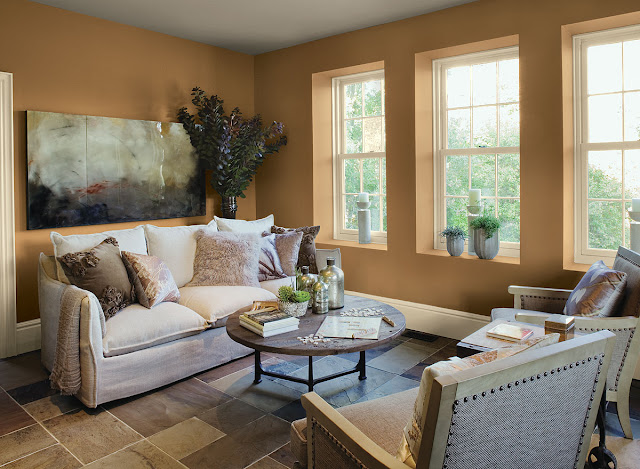 attractive living room paint color ideas with brown accent wall and three white bay windows