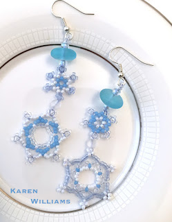 each earring features two linked snowflakes, topped with a cultured sea glass bead.