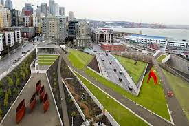 view of olympic sculpture park and seattle skyline