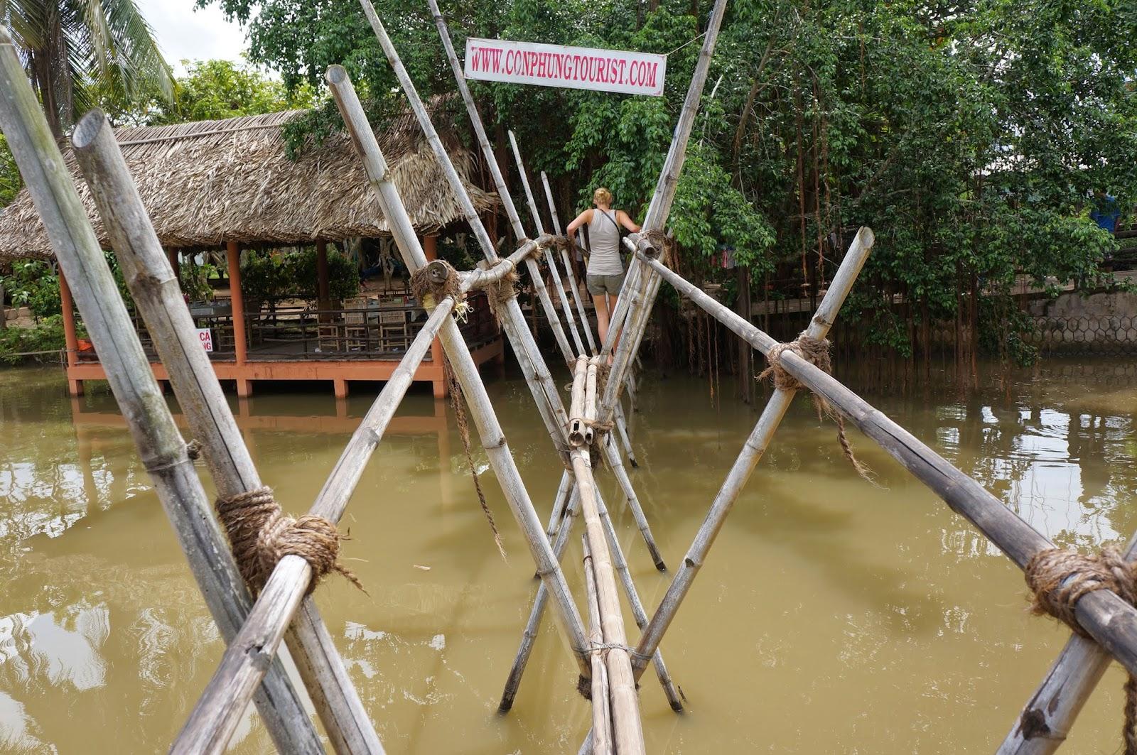 Crossing this rickety bamboo bridge