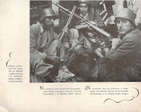 Page from Visions anti-fascist publication showing citizens holding rifles and machine guns behind a barricade.