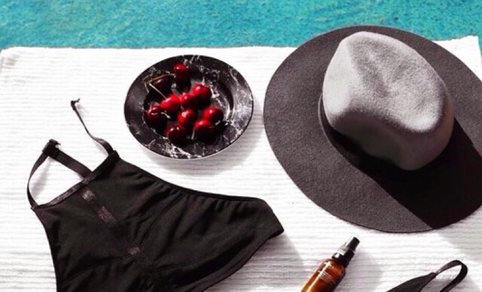 poolside flat lay off figure styling cherries