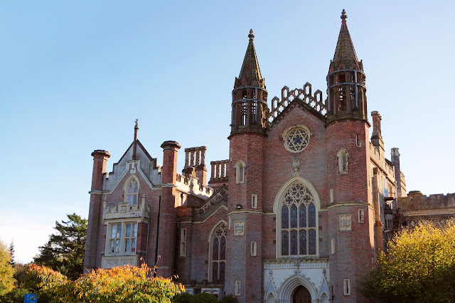 conishead priory- a huge, ornate Victorian building built in red brick with beige window surrounds