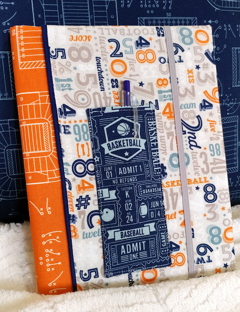 Use Game Day fabrics to create a color block notebook cover