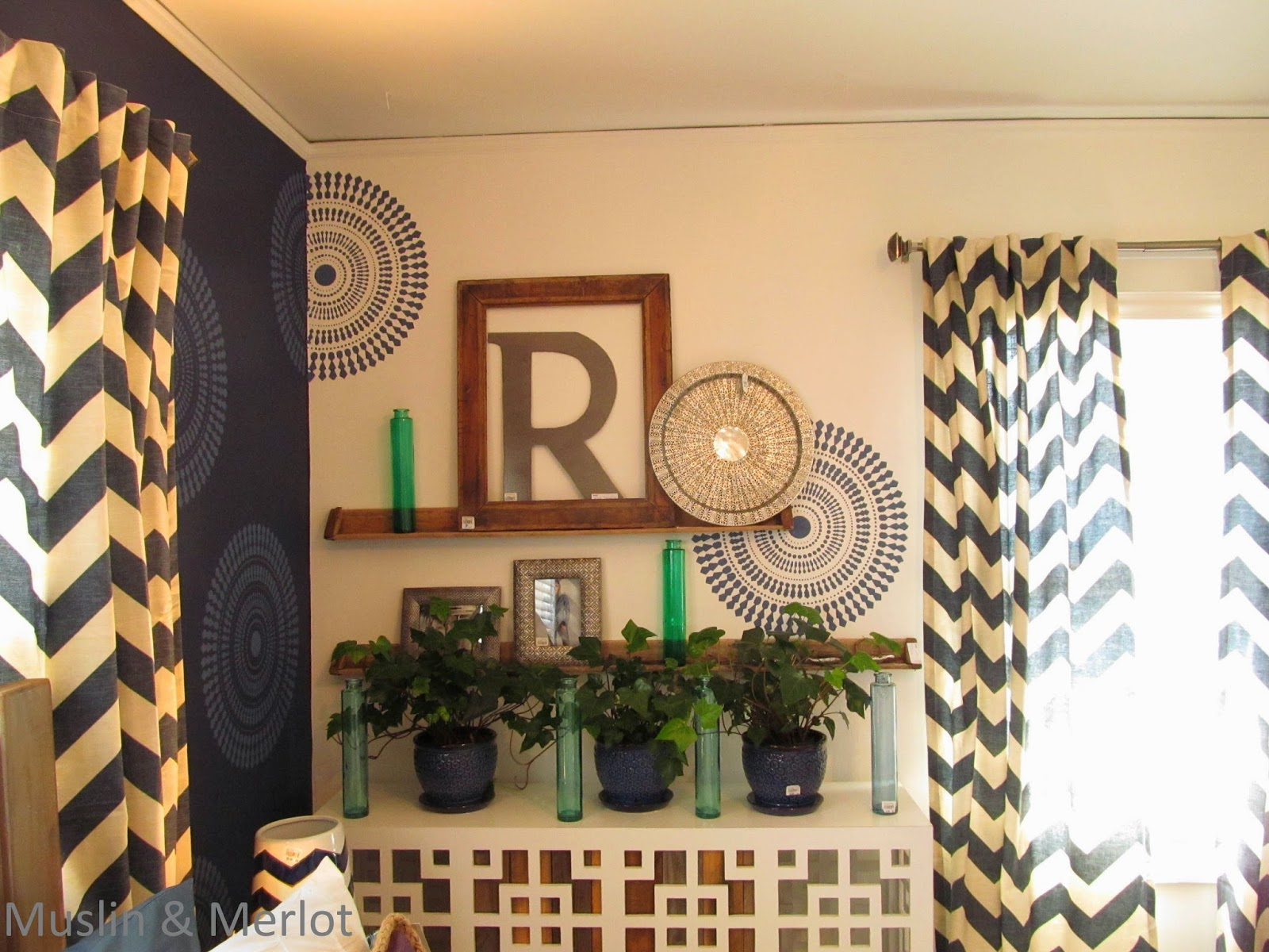 Stenciled walls, chevron curtains, shelves made of chicken feeders!