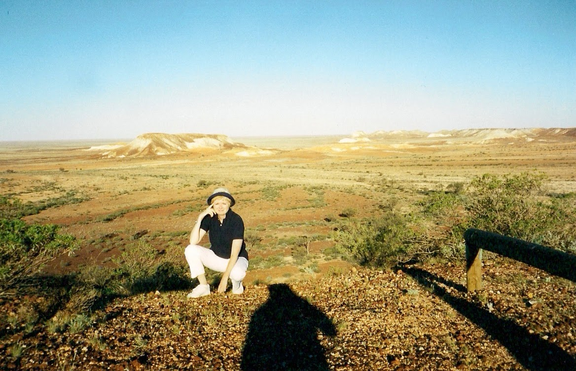woman crouching in desert in Australia