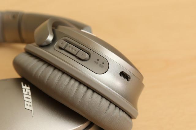 電量與藍牙指示燈,上方的按鍵為音量調整與中央的多功能按鍵