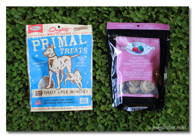 Primal turkey liver treats and Fromm Salmon & Sweet Potato treats from Chewy on a bed of clover