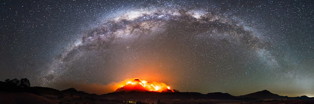 Panorama of the Milky Way Galaxy above Mt Barney during a massive fire