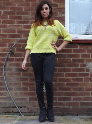 Person wearing a neon yellow jumper