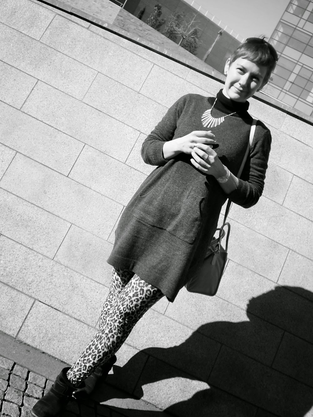 Funky fancy leopard print leggings, grey knitdress, biker boots are the main ingredients for this casual outfit - Below the Skyscraper | Funky Jungle, fashion and personal style blog