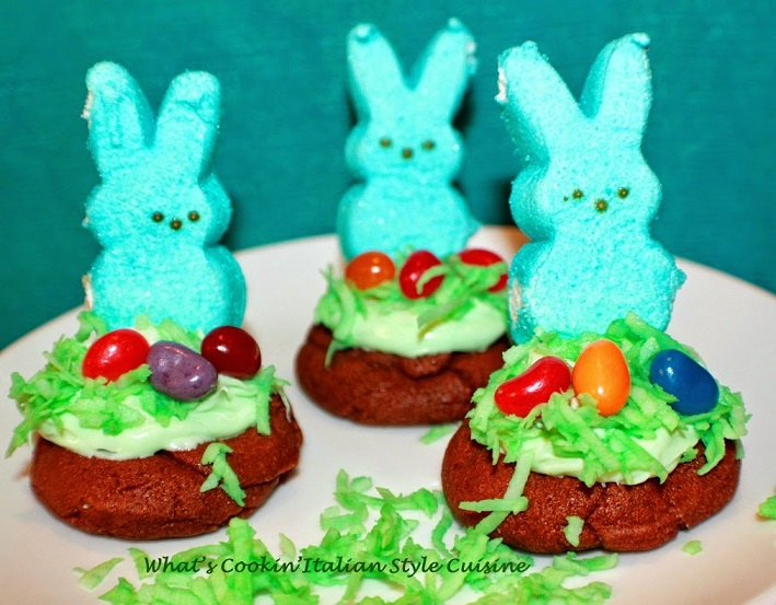 these are chocolate cookies with peeps and jelly beans decorated for Easter with coconut