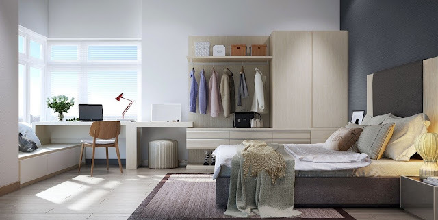 Coats hang beneath the open shelf with plenty of room for shirts in the wardrobe beside it