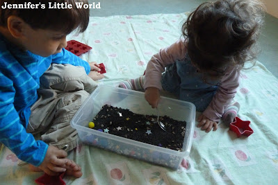 Children playing with a sensory tub