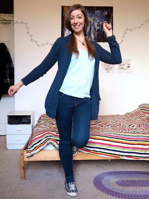Stitch Disneybound inspired outfit of light blue top, with dark blue cardigan and skinny jeans