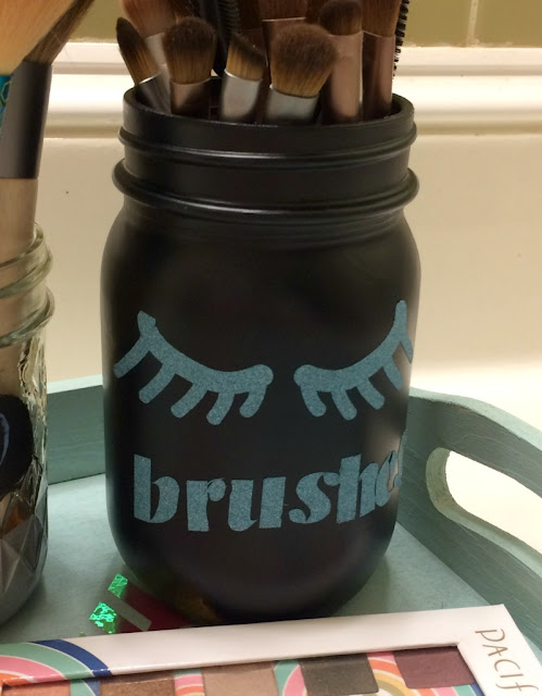 I used chalkboard paint and glitter vinyl to re-purpose mason jars into decorative holders for my makeup brushes.