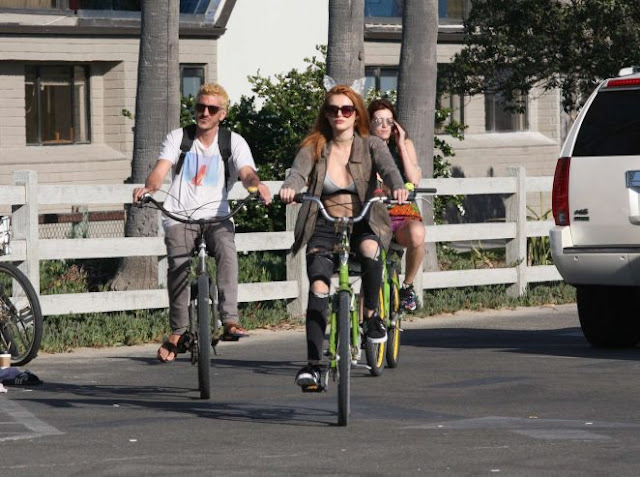 Bella Thorne in Jeans Riding a bike in Los Angeles