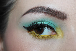 bright yellow teal blue eye makeup dramatic winged liner