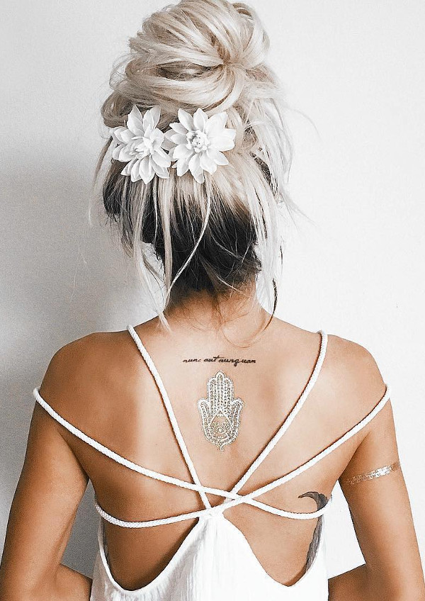 messy hairstyle with flowers